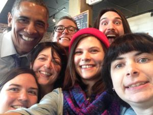 President Obama poses for a selfie with staff at Charmington's in Baltimore. Charmington's is among a number of businesses that support access to paid sick days in Maryland.
